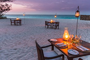 Risultati immagini per candle light dinner on the beach  300x200